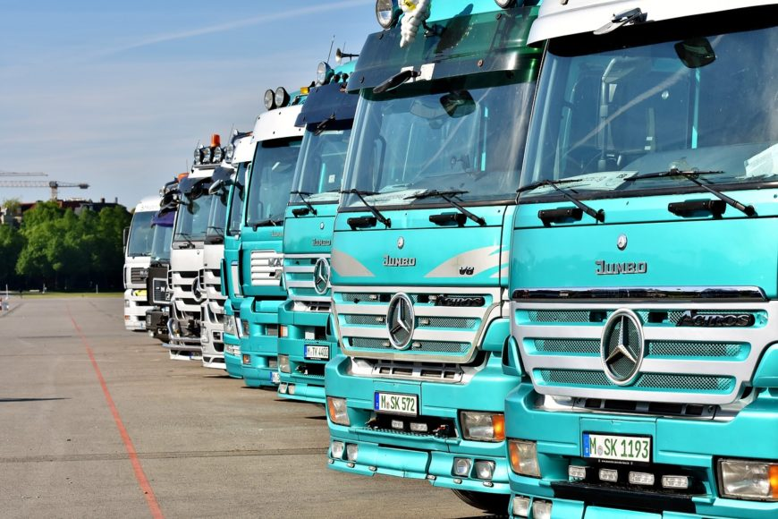A line of Mercedes-Benz HGV's (Heavy Load Vehicles).